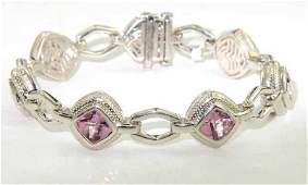 318: Charles Krypell 14K Gold/Silver Pink Topaz Bracele