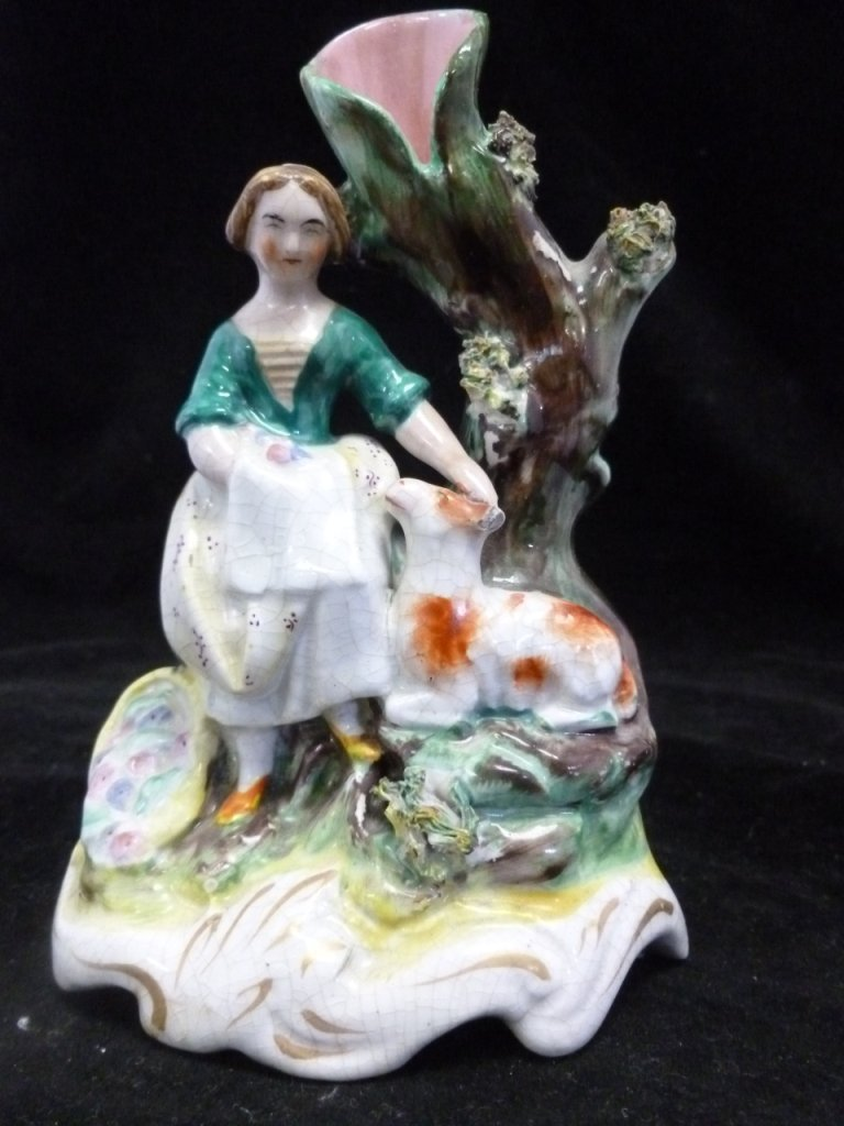 19th Century Staffordshire girl with lamb spill holder