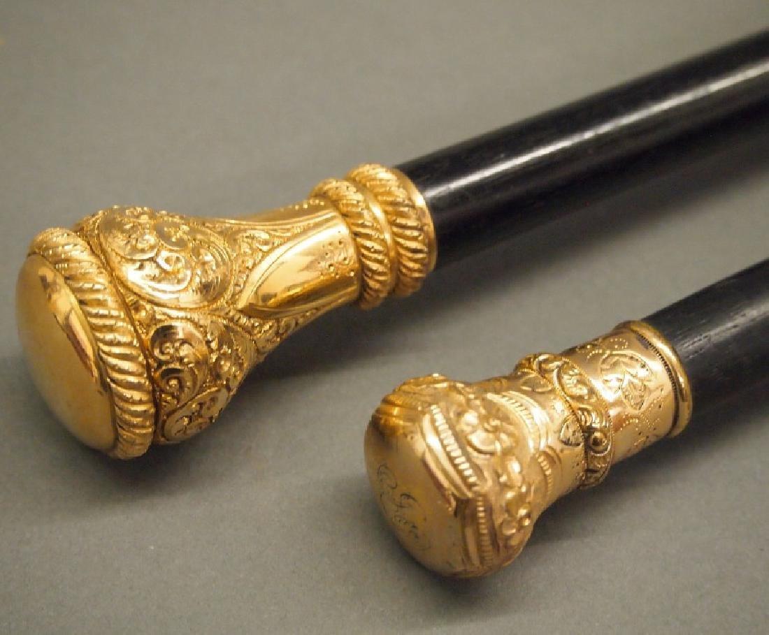 2 Victorian walking sticks