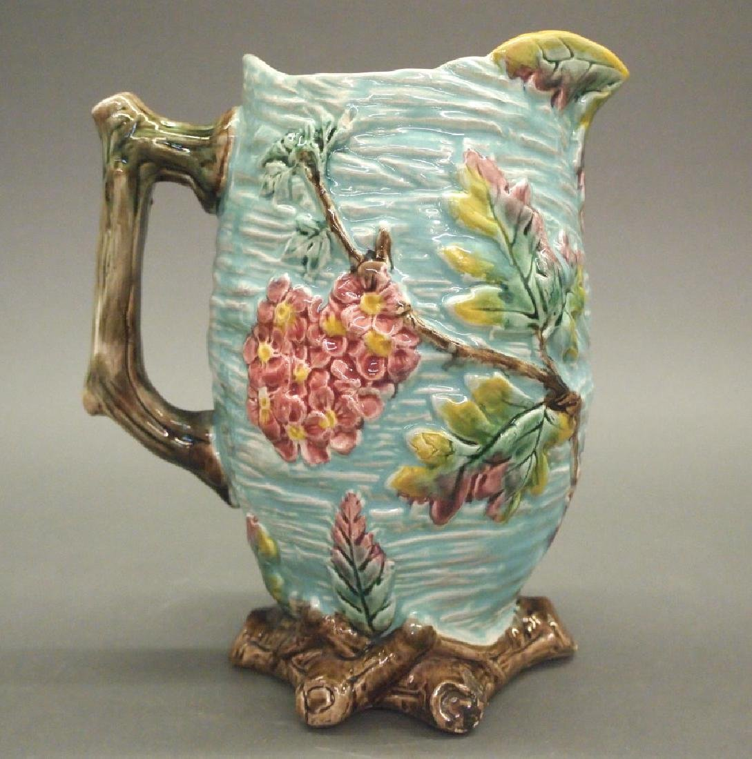 Majolica pitchers and centerpiece bowl