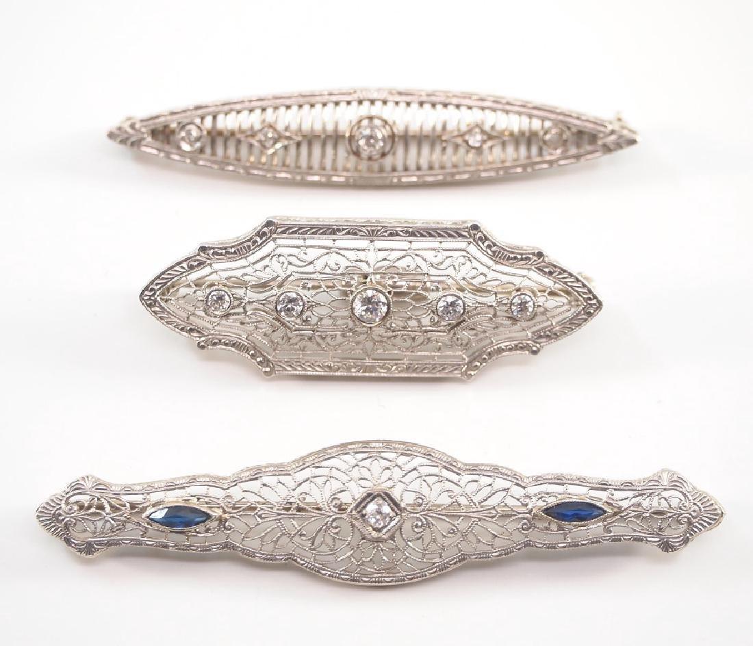 3 14kt white gold filigree & diamond brooches