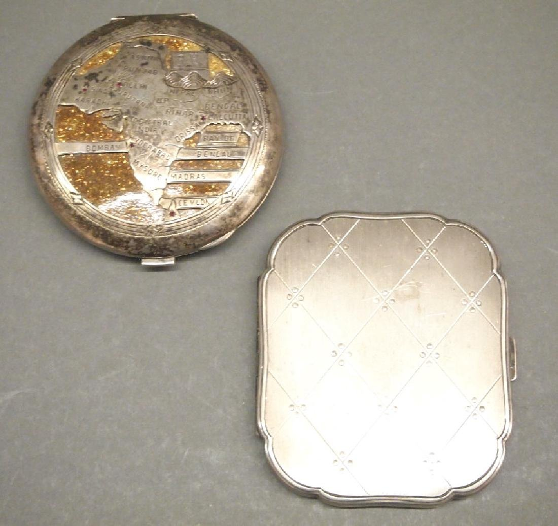 Two Silver compacts