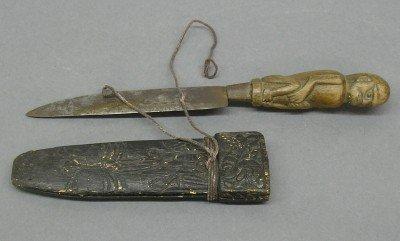 12: Mandau type knife
