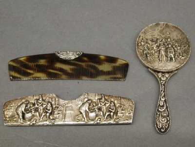 15: Silver comb and mirror