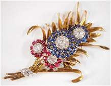 18k pin with Diamonds, Rubies and Sapphires