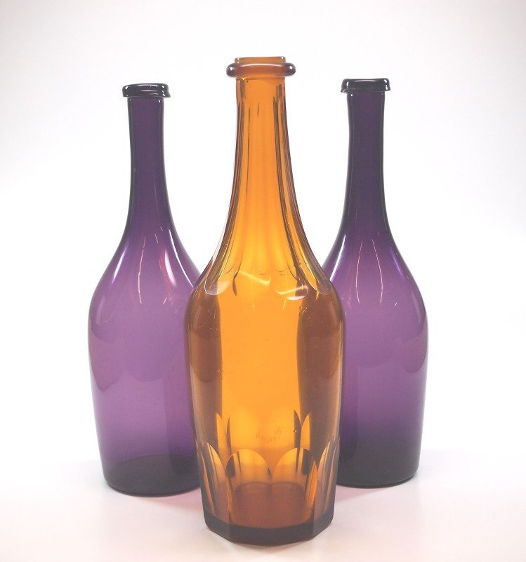 Free-blown and cut bottles, three