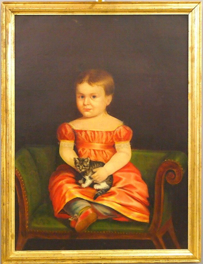 Portrait of a girl with kitten
