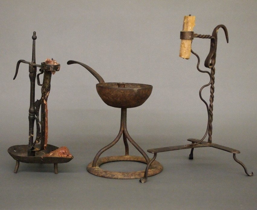 2 Iron candleholders and a grease lamp