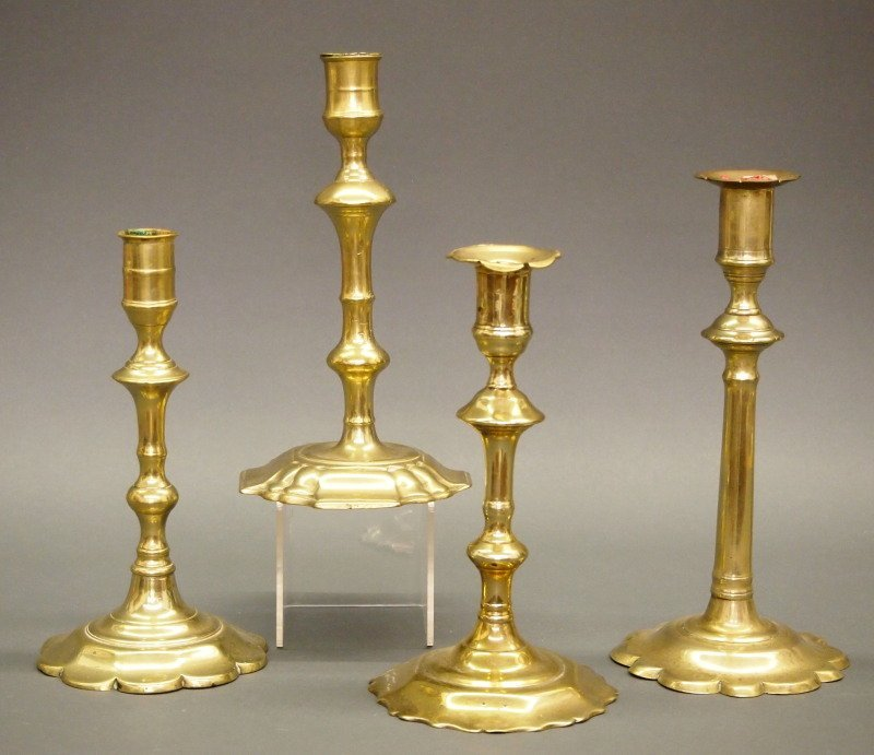 4 18th c brass candlesticks