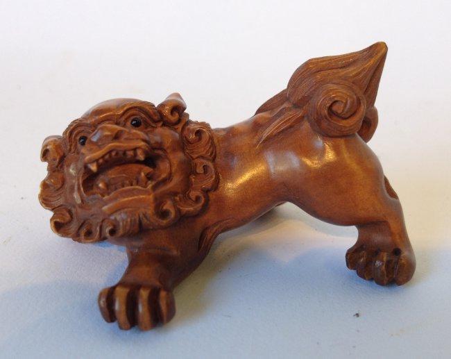 Carved boxwood japanese foo dog netsuke lot