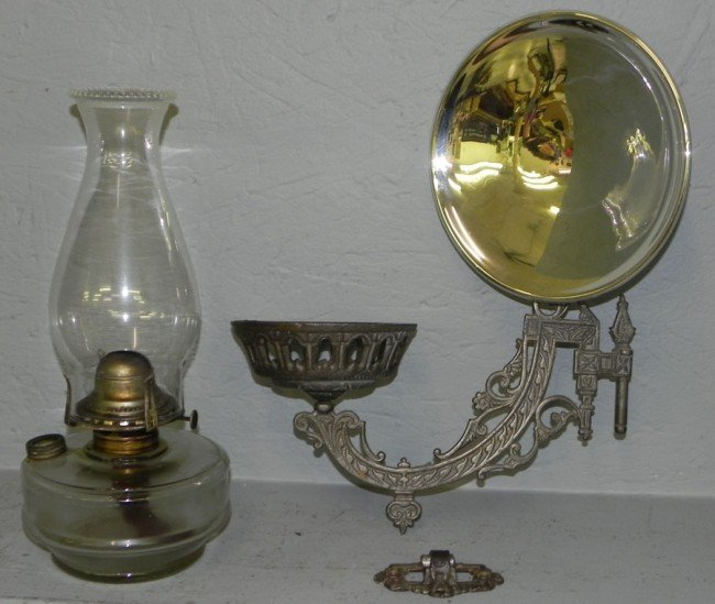 246: Antique oil lamp with cast iron wall bracket : Lot 246
