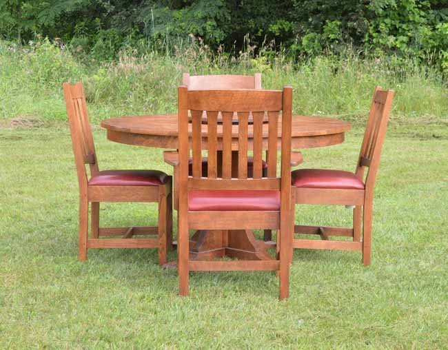 stickley oak dining room table and 4 oak chairs lot 228