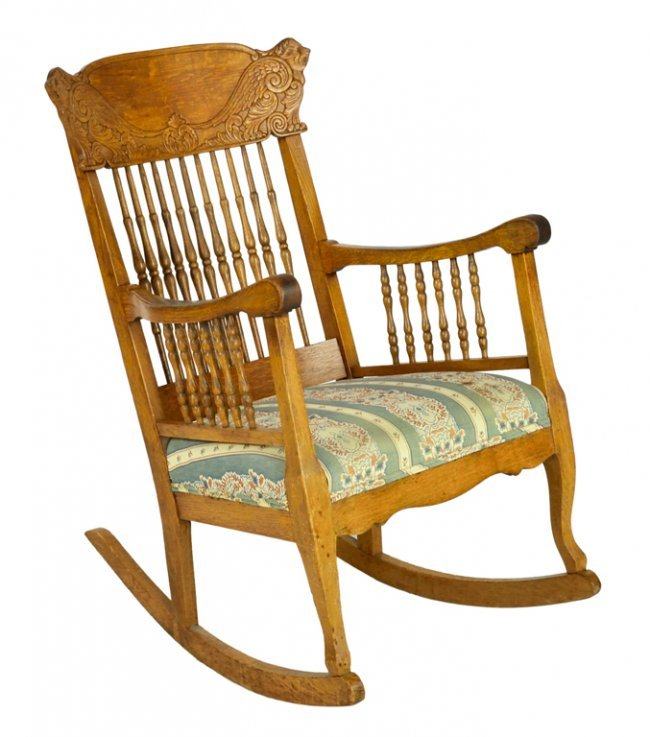 an antique windsor style rocking chair lot 57
