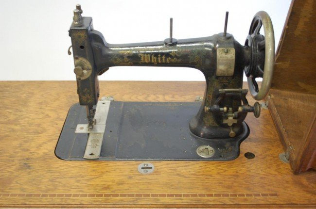 antique white brand sewing machine