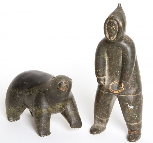 Two inuit stone carvings bear and man signed lot