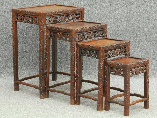 Set of chinese carved nesting tables circa ea
