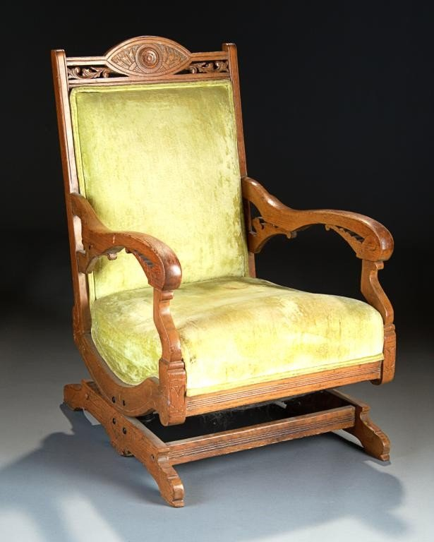 131 a victorian carved oak upholstered rocking chair lot 131