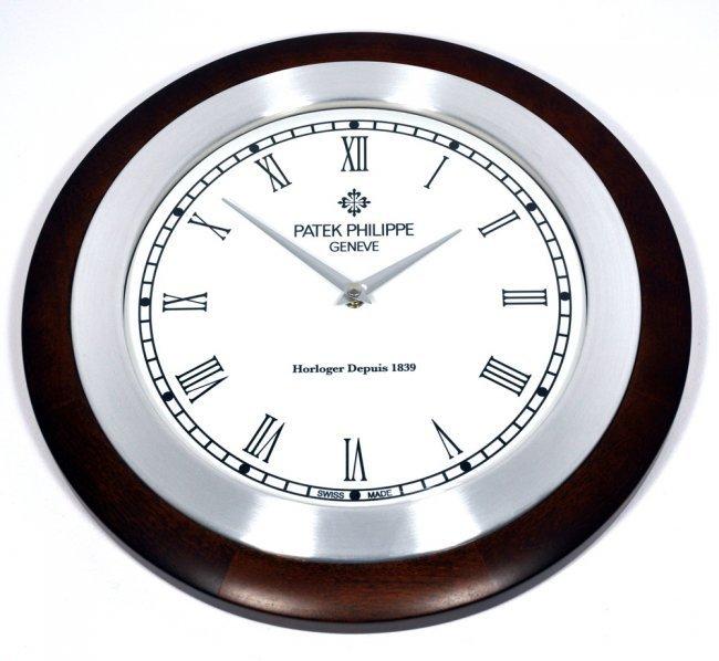 Patek Philippe Calatrava Wood Dealer Clock Lot 77