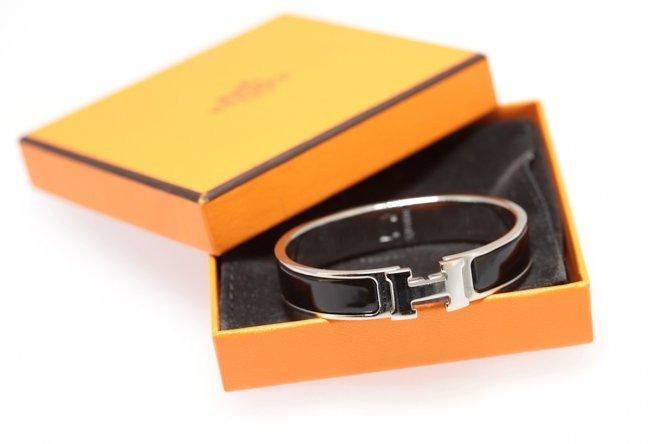 silver and enamel hermes quot clic clac h quot bracelet lot 221