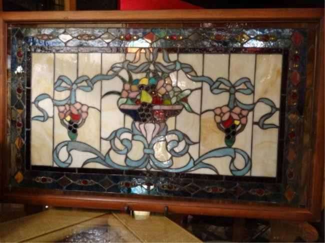 stained glass panel urn with ribbons in wood frame