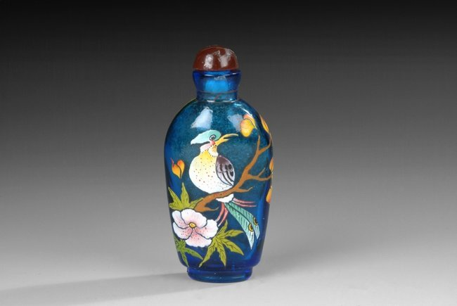 A Multi Color Enameled Overlay Blue Glass Snuff Bottle