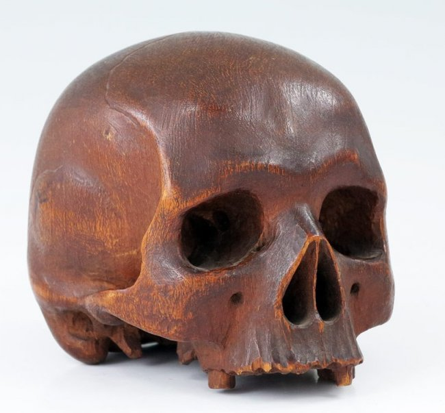 Early carved wooden skull lot