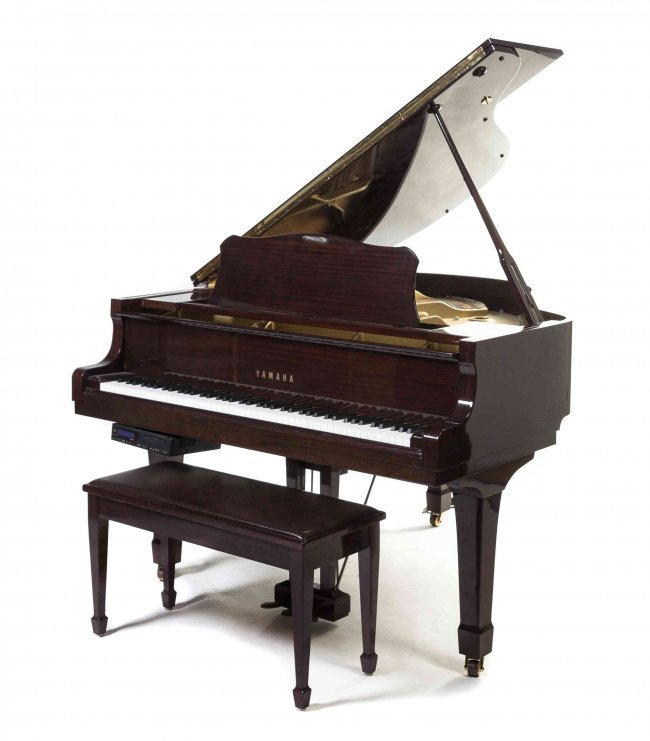 A yamaha baby grand piano length 55 inches lot 710 for Size of a baby grand piano