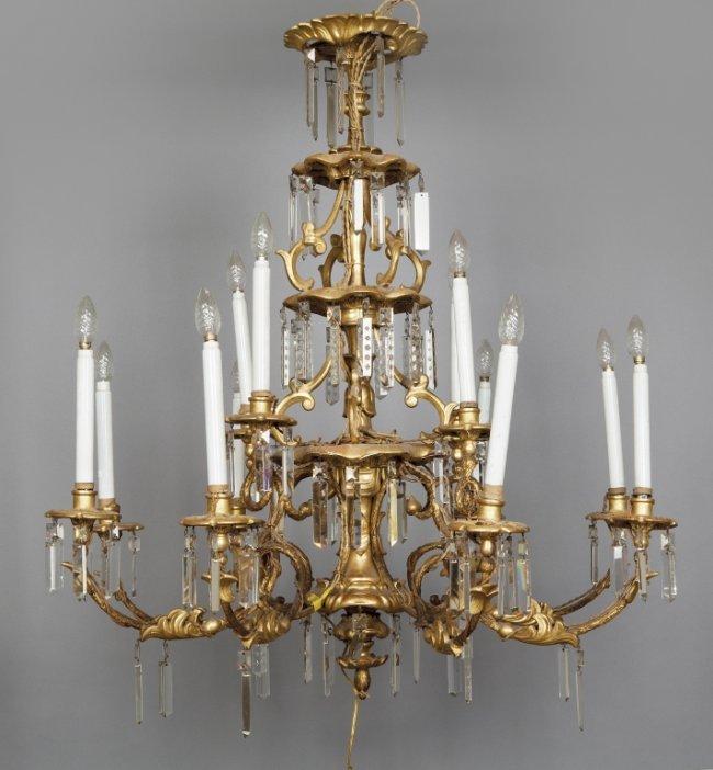 Lampadario in legno dorato a 12 luci disposte su : Lot 411