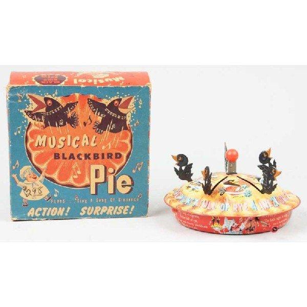 96 tin mattel musical black bird pie toy