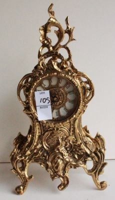 105: 105. Antique Style French Rococo Mantel Clock.