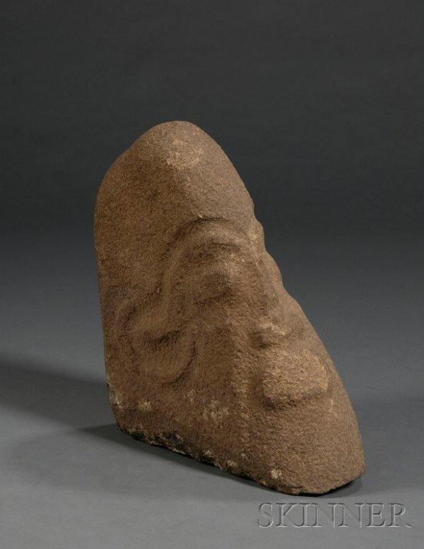African carved stone head cross river probably p