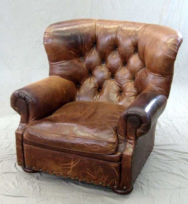 76 large distressed leather club chair 20th c by po lot 76