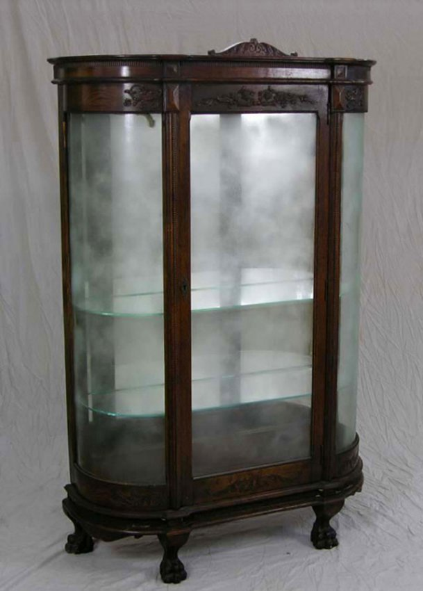 1188 carved oak curved glass curio cabinet c 1900 w. Black Bedroom Furniture Sets. Home Design Ideas