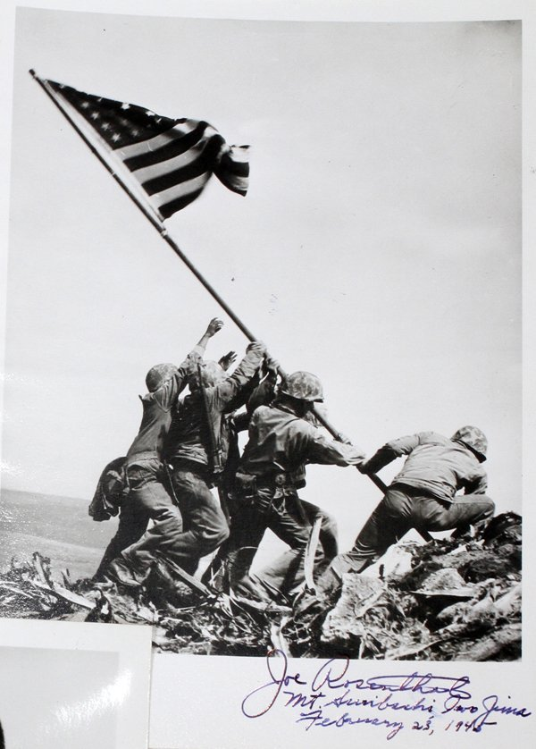 impact of iwo jima photograph The battle of iwo jima was fought between the japanese army and the united  states  national cemetery based on the famous raising the flag photograph.
