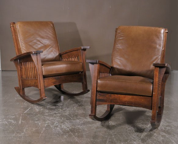 363: Two mission oak style rocking chairs with brown le