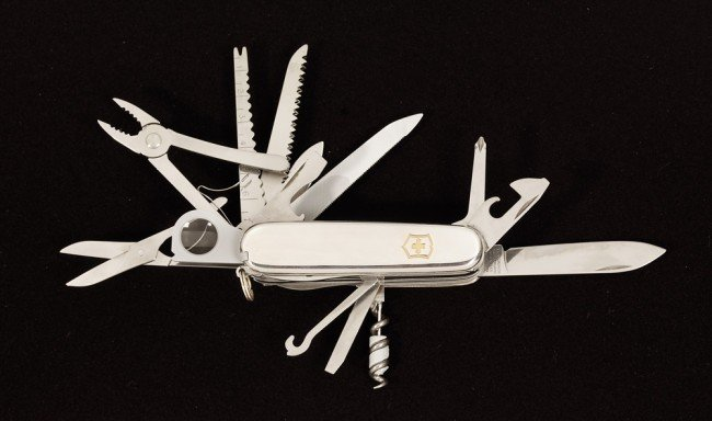 11 A Tiffany Sterling Silver Swiss Army Knife Is A V