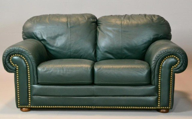 794 a green leather sofa matching loveseat lot 794