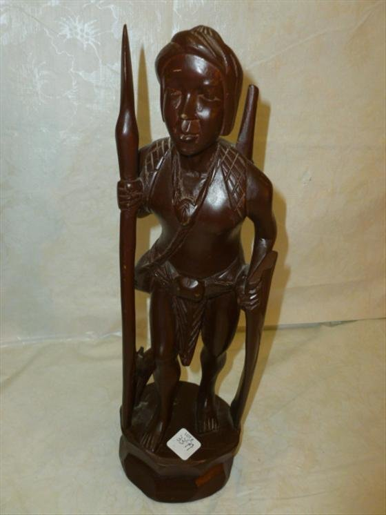 Hand carved dark wood very light man with spear lot